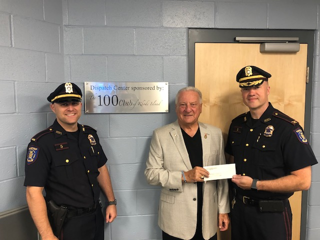 Joe Terino presents Portsmouth Police Chief check for plaque